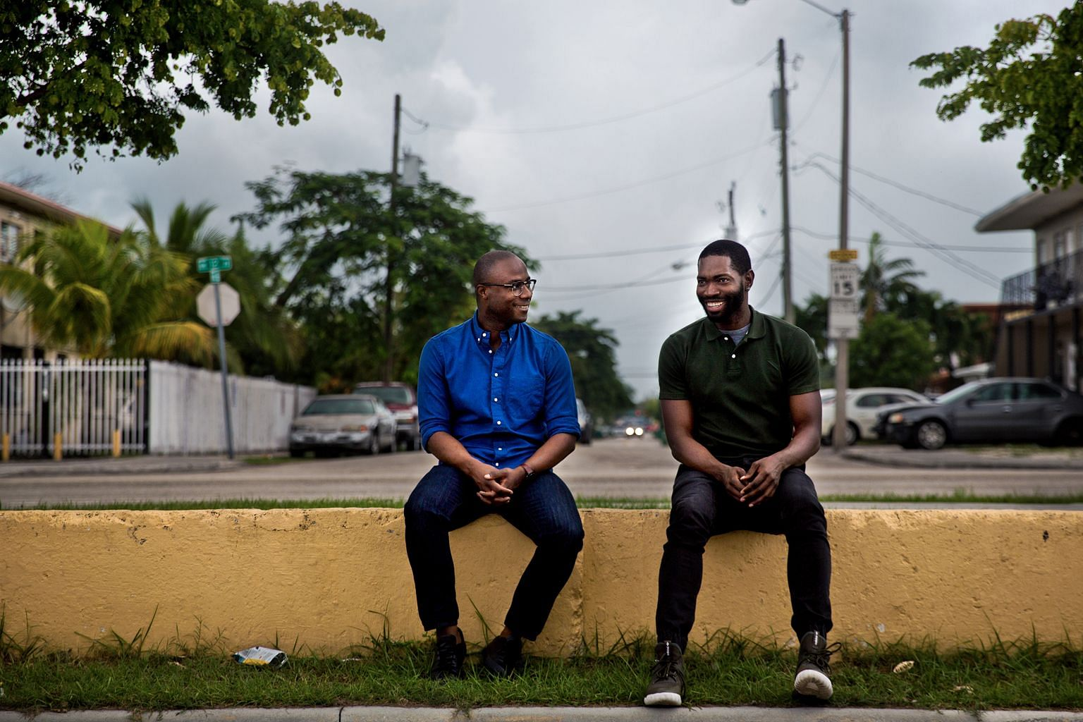 Moonlight director Barry Jenkins (far left) and writer Tarell Alvin McCraney in the Liberty Square housing project in Miami where they grew up.