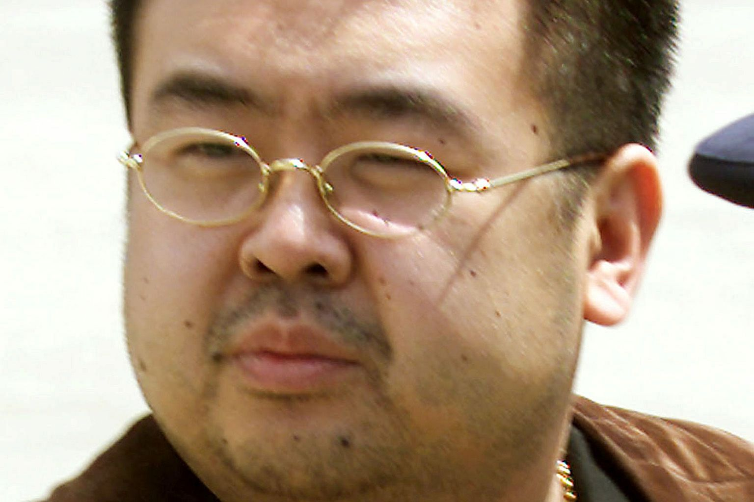 Officials used a photo of Mr Kim and matched the positions of the moles with those on the body in the morgue.