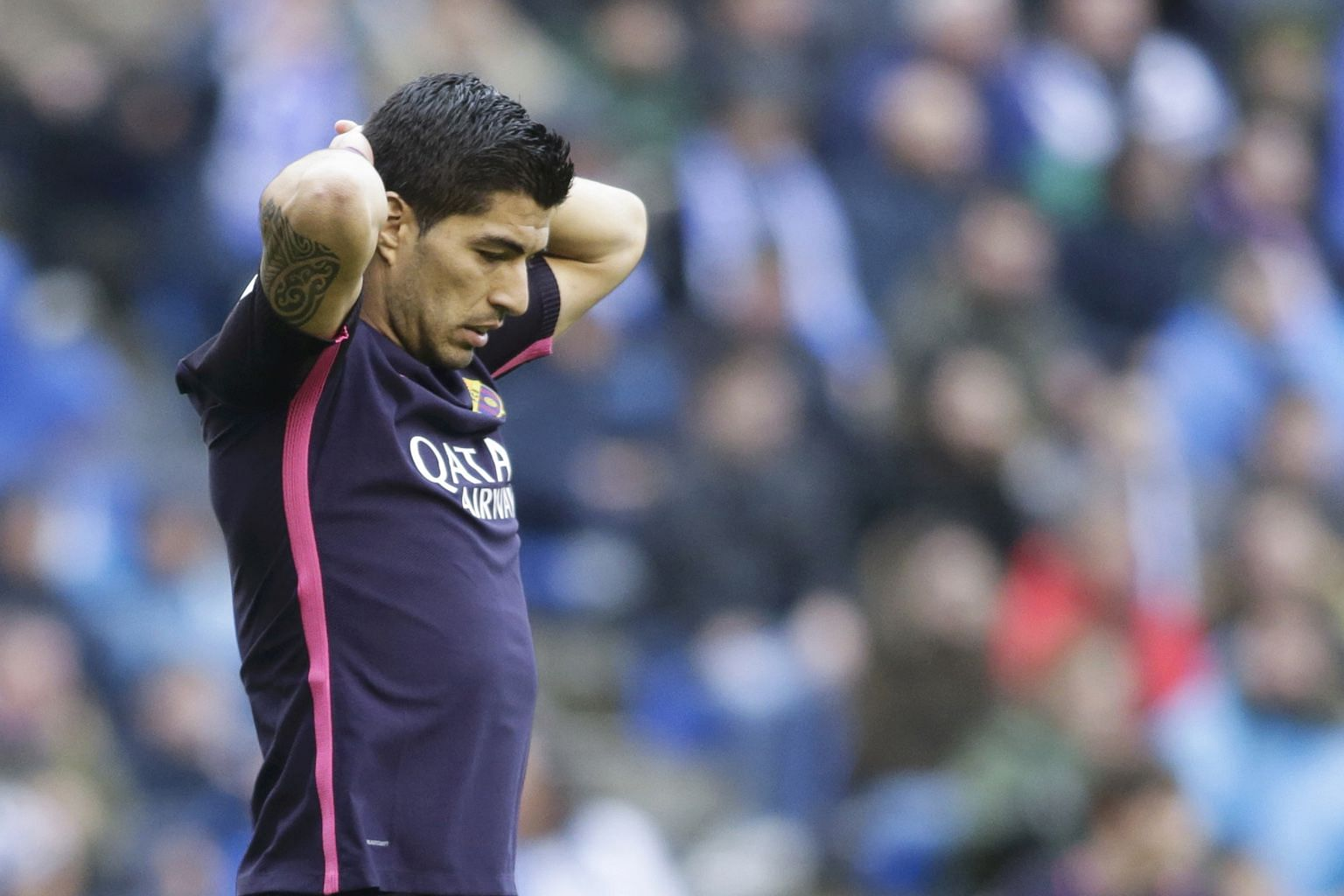 """A frustrated Luis Suarez, who scored Barcelona's equaliser at Deportivo. Poor defending from corners cost them in the 1-2 loss, as they conceded top spot in La Liga to Real and Barca manager Luis Enrique knows they need a """"very strong"""" finish to secu"""