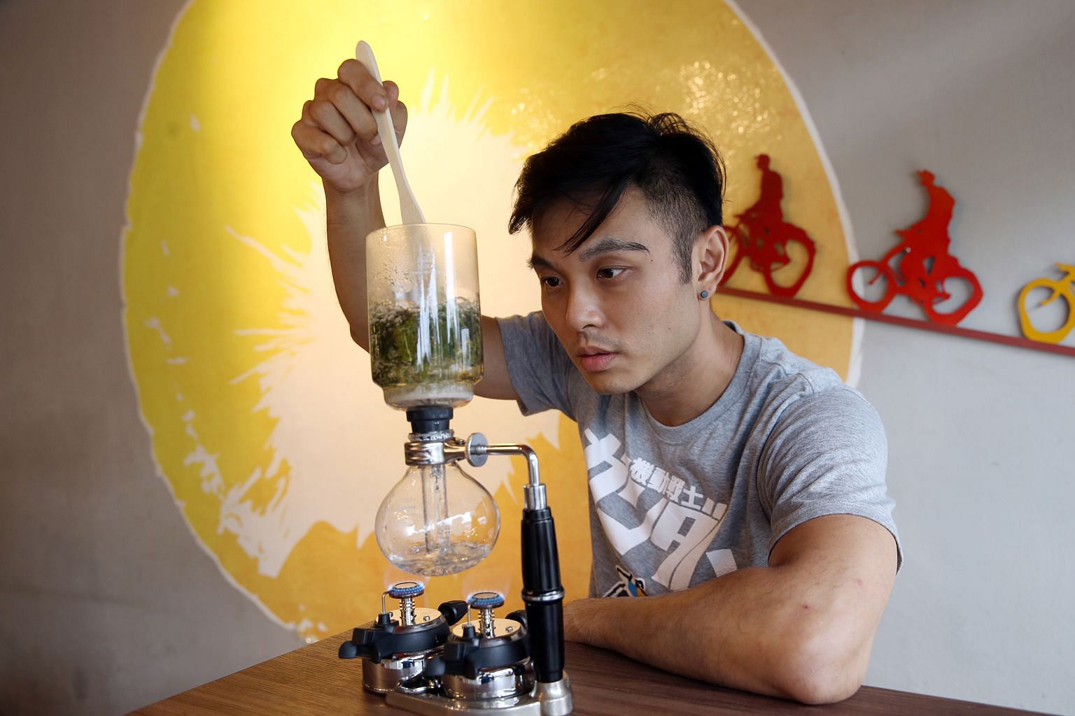 Sun Ray Cafe owner Dave Lim making tea in a coffee brewer. He is participating in the international Tea Masters Cup later this year.