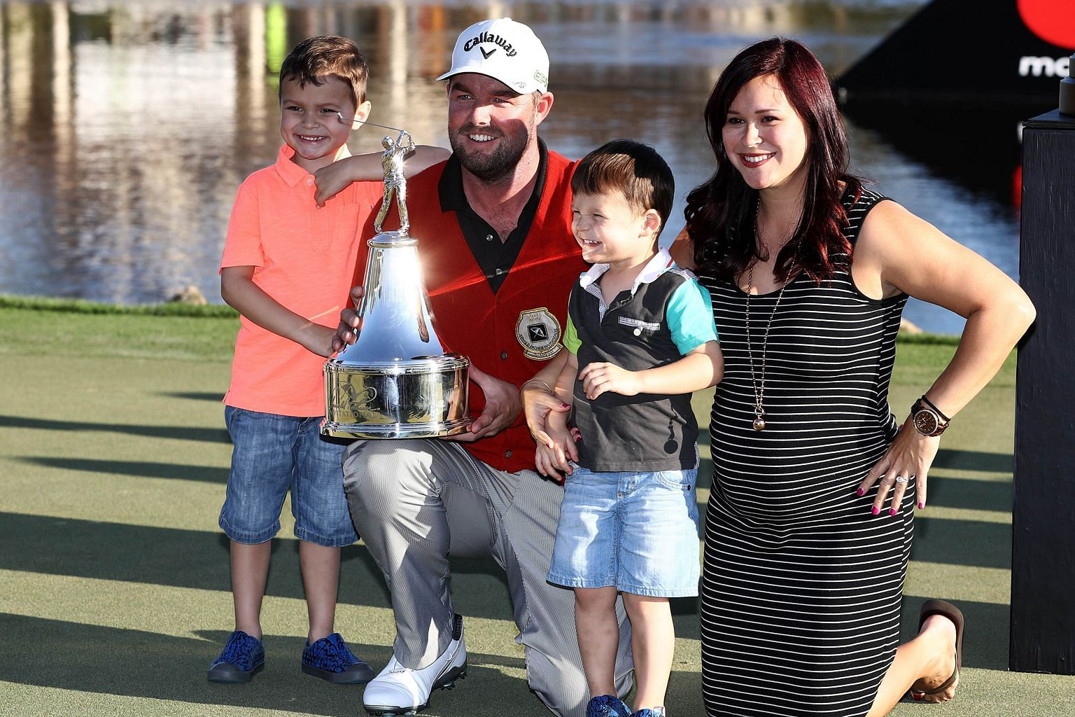 A dream come true for the family as Australian Marc Leishman celebrates with expectant wife Audrey and sons Harvey and Oliver after winning the Arnold Palmer Invitational in Orlando, Florida.