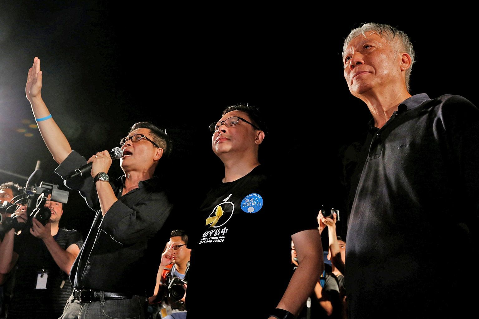 Occupy Central founders (from left) Chan Kin Man, Benny Tai and Chu Yiu Ming kicking off the movement in Hong Kong on Aug 31, 2014.