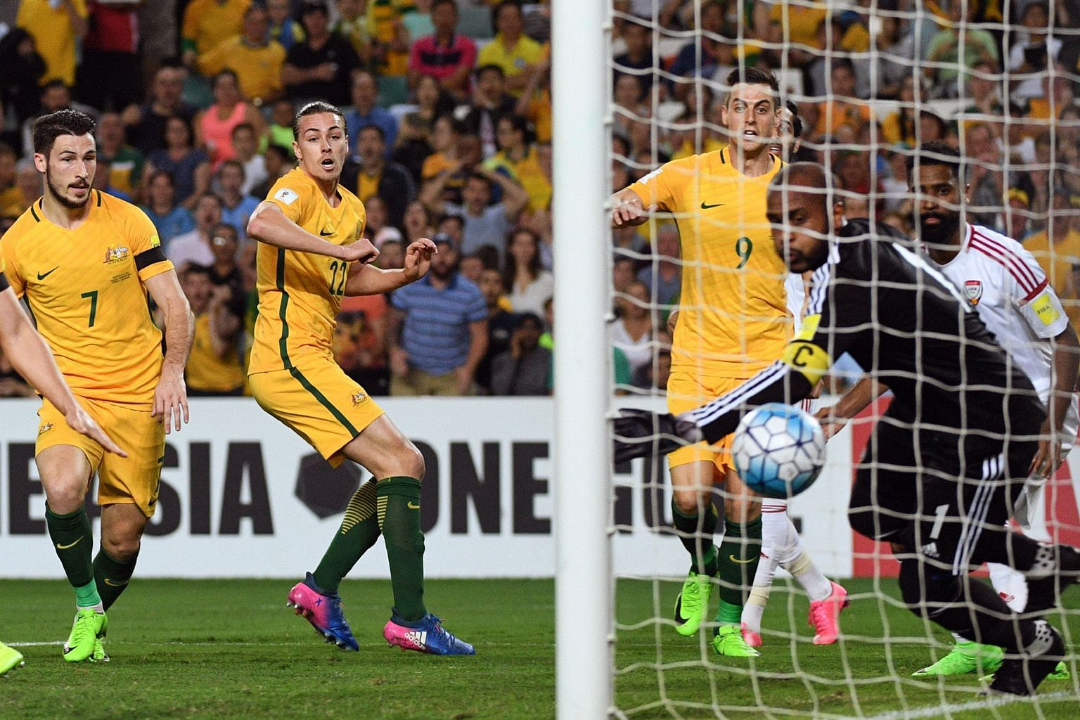 Jackson Irvine (second from left) and team-mates (from left) Mathew Leckie and Tomi Juric watching the ball cross the line from his header for the first goal.