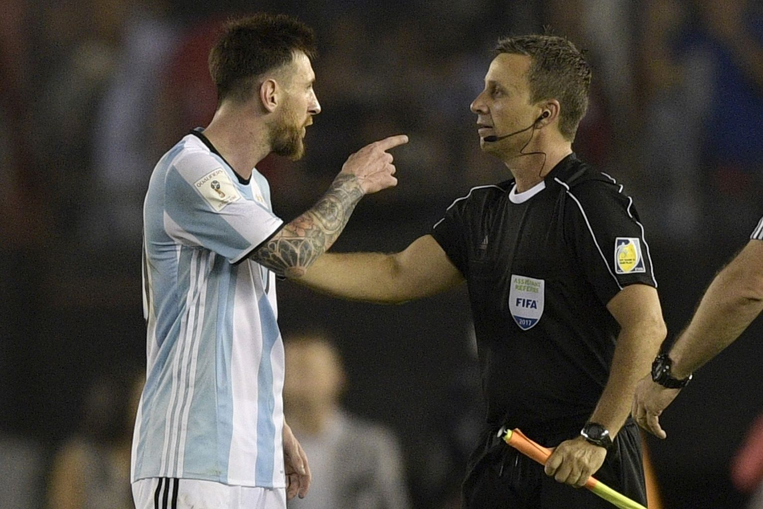 Argentina's Lionel Messi arguing with linesman Emerson Augusto de Carvalho at the end of the qualifier against Chile. He has been banned for four matches.