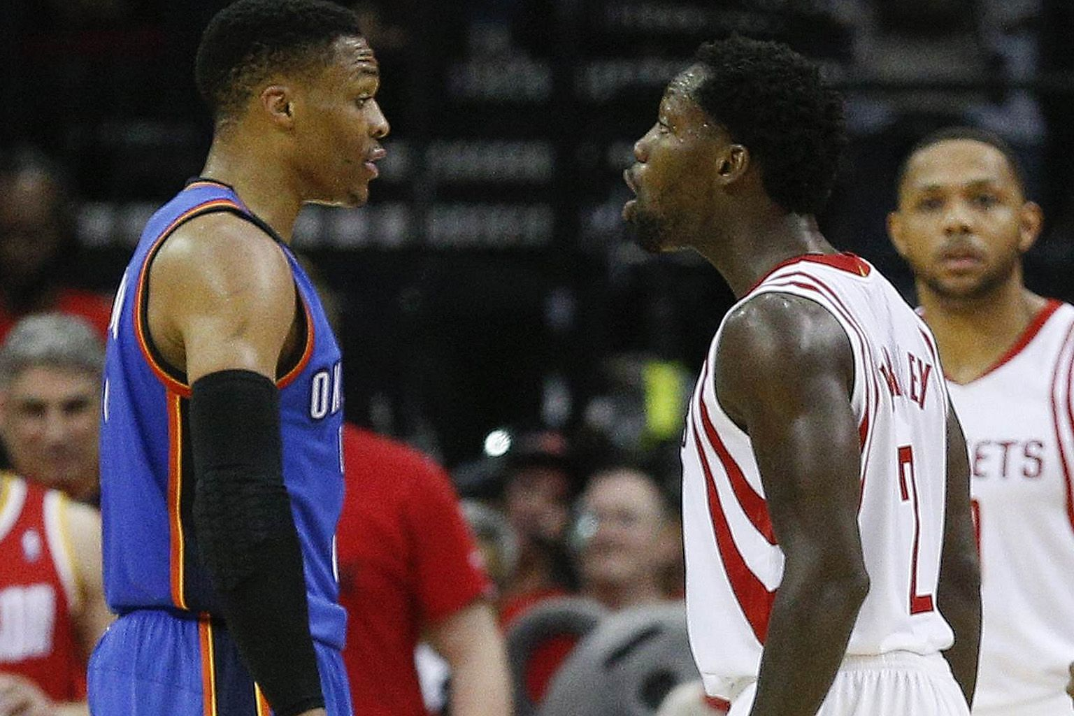 Oklahoma City Thunder's Russell Westbrook (left) and Houston Rockets' Patrick Beverley exchanging words during Game Five. Westbrook had 47 points but the Rockets won 105-99 to clinch the series 4-1.