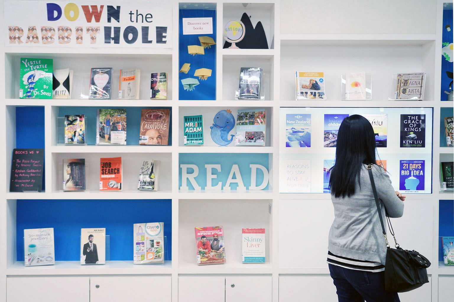 A section at Sengkang Public Library which combines a book display and an interactive screen showing e-book titles. The number of physical items checked out from public libraries fell by more than 15 per cent from around 38 million in 2012 to about 3