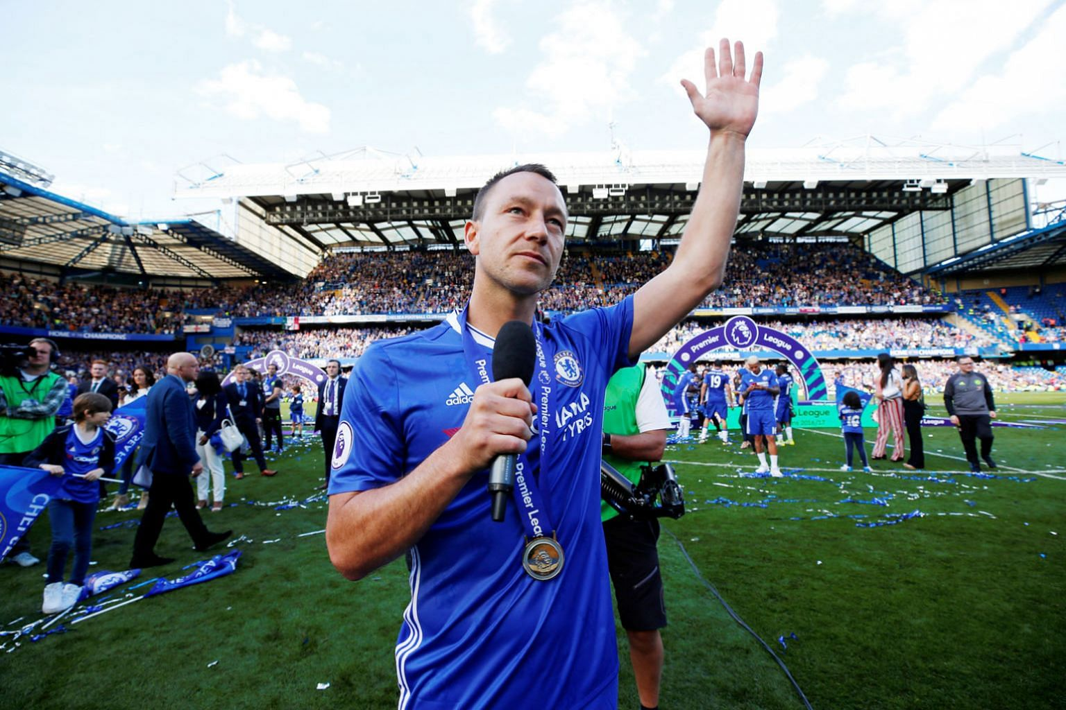 John Terry acknowledging the crowd after making a speech at the end of his last game for Chelsea, against Sunderland on Sunday. Thousands of pounds were won in bets on Terry being substituted in the 26th minute, to match his shirt number.