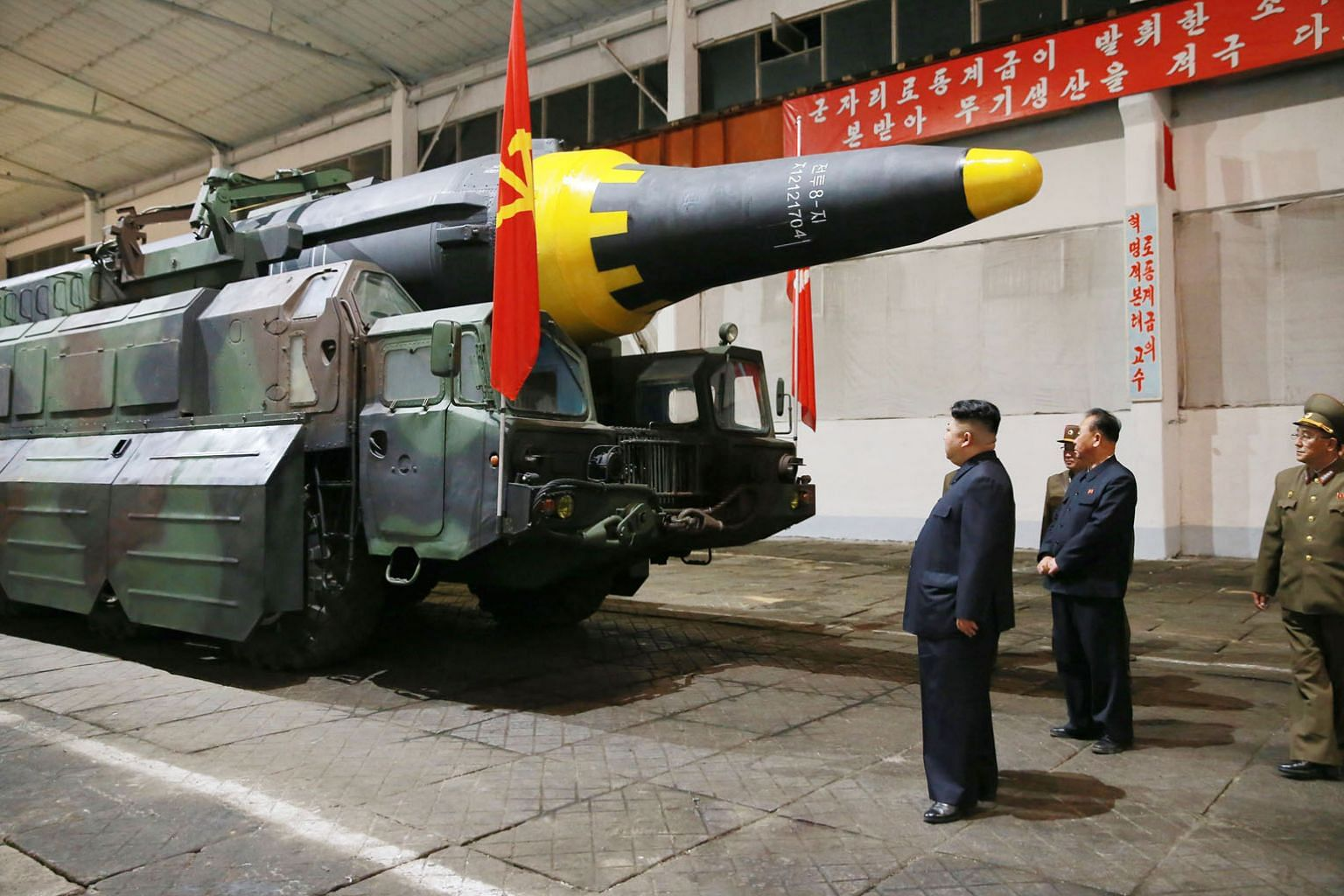 North Korean leader Kim Jong Un checking out a missile after Pyongyang test-fired a new ballistic missile, which it says is capable of carrying a big nuclear warhead, earlier this month.
