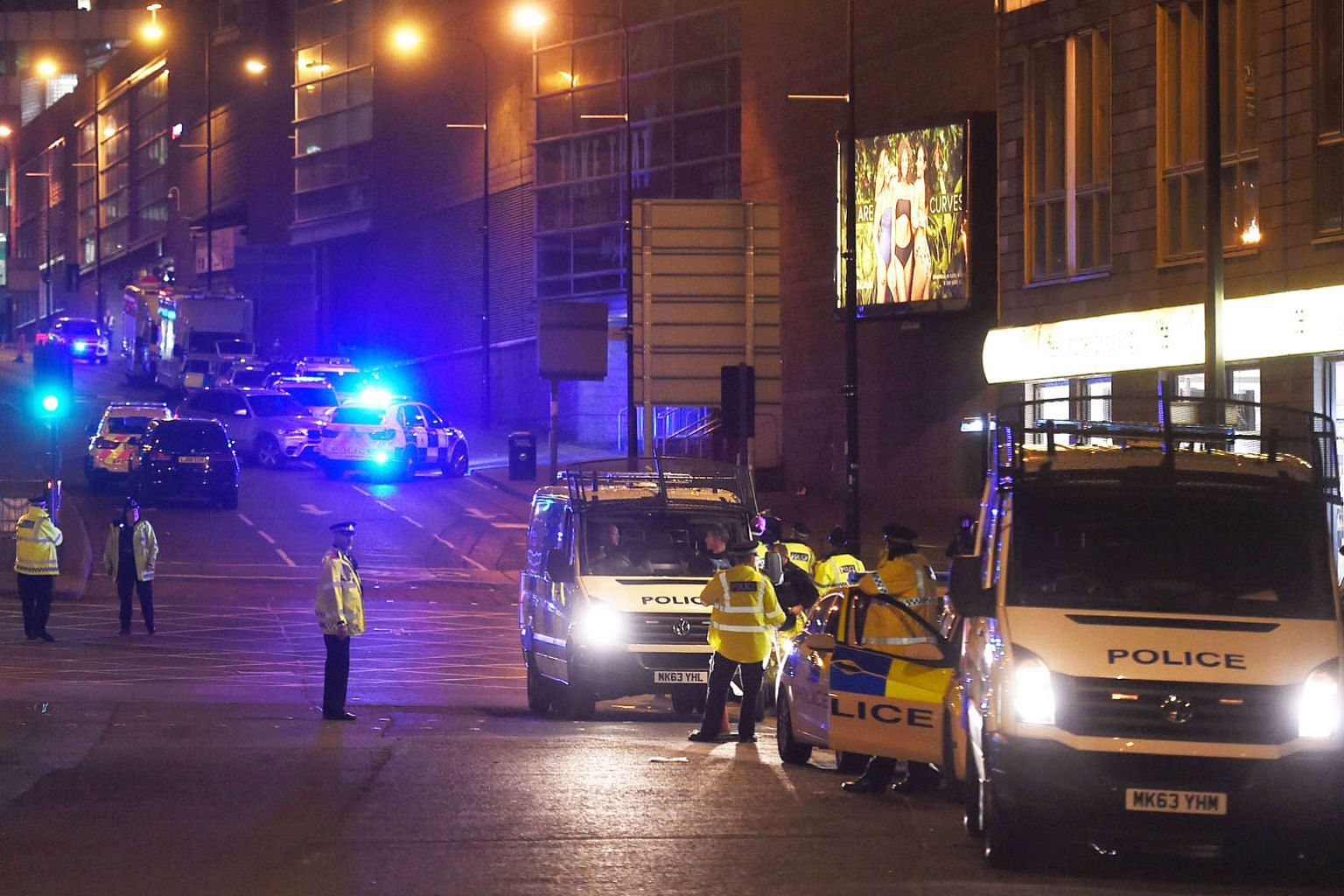 Police at the scene of the recent bombing in Manchester, England. The Singapore Government has constantly stressed the heightened threat levels here as the Republic is a high-value target.