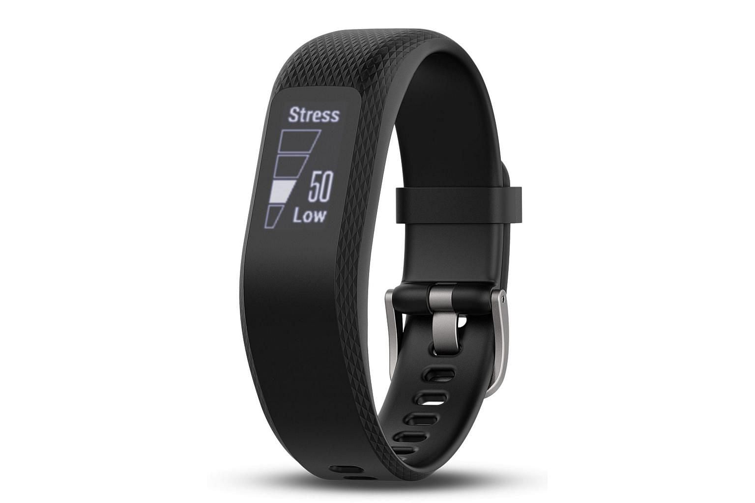 While not much of a looker, the Garmin vivosmart 3 (far left) is very comfortable to wear. Its watch-like clasp provides a secure fit on the wrist.