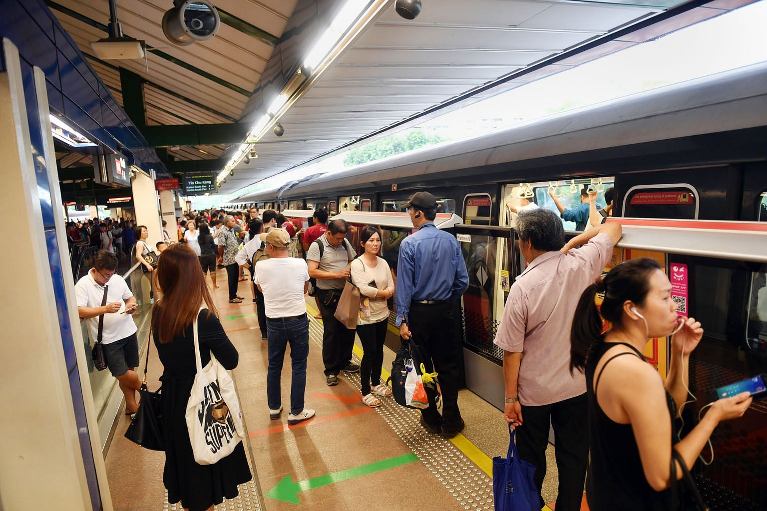 Commuters at Khatib MRT station waiting after a signalling fault disrupted train services on the North-South Line on Wednesday.