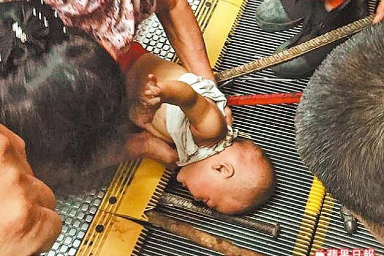 Toddlers Arm Stuck For  Minutes In Escalator In China East Asia News Top Stories The Straits Times