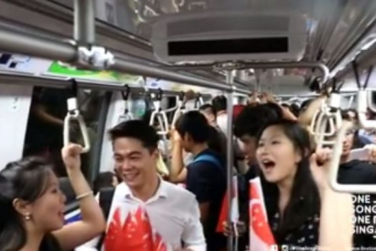 Commuters on MRT train join flash mob performance of NDP classic Home,  Singapore News & Top Stories - The Straits Times