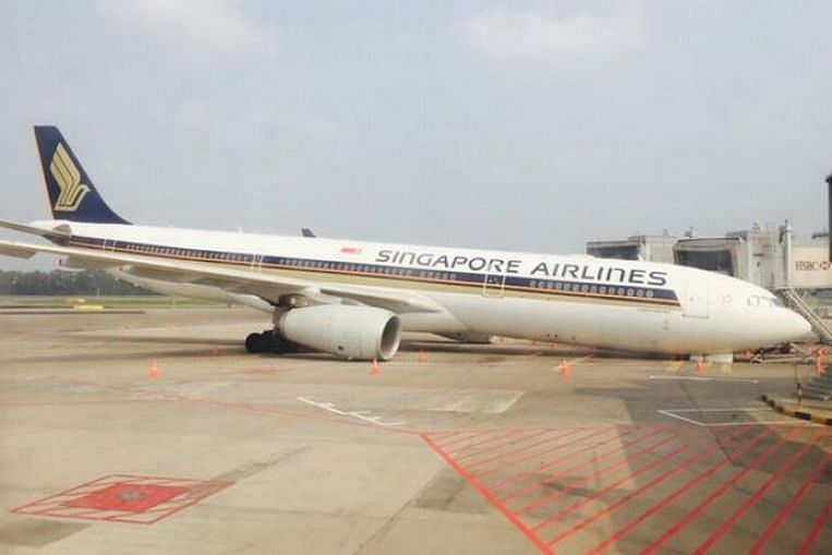 sia plane collapses at changi airport gate after nose gear