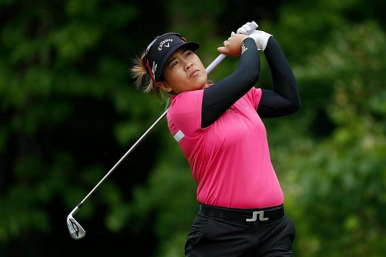Ariya Jutanugarn of Thailand watches her tee shot on the seventh hole during the final round of the LPGA Volvik Championship on May 28, 2017. Image: AFP