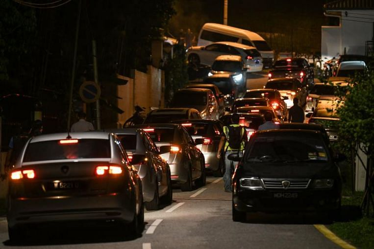 Increased police presence outside Najib's house, police also enter his condo: Reports