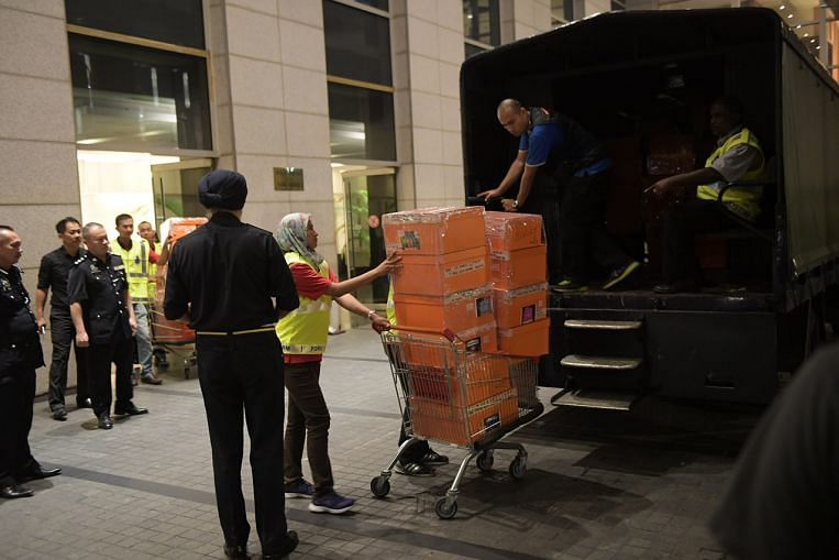 Dozens of Hermes Birkin bags and other items seized from Najib-linked apartment