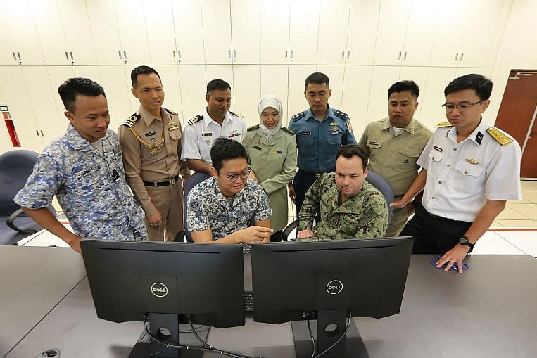 Liaison officers from the navies from the United States, Singapore, Bangladesh, Indonesia, Malaysia, Thailand, Brunei, Vietnam and the Philippines planning for Exercise Seacat at the RSS Singapura - Changi Naval Base yesterday. Image: MINDEF
