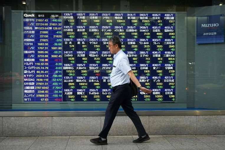 Asia shares wobble as china halts trade talks with us; oil rallies