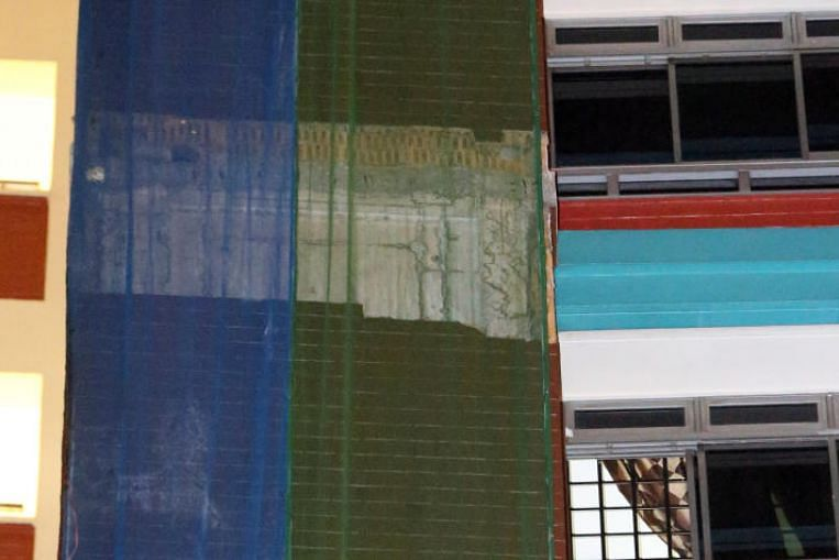 Bricks fall from ninth-storey HDB external facade; AHTC working with relevant authorities