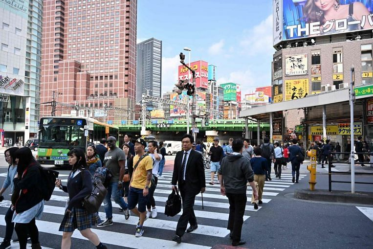 The average expatriate pay package provided by companies in Japan to mid-level employees is US$386,451 (S$532,104) a year. Image: AFP