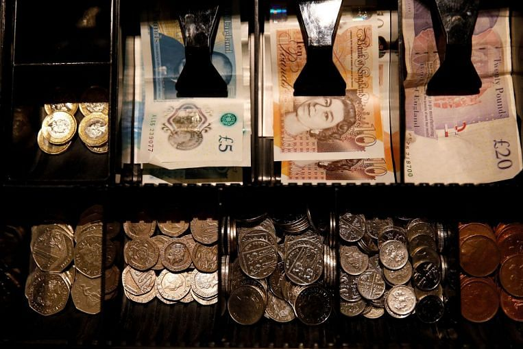 Pound sinks below US$1.24 engulfed by 'perfect storm'