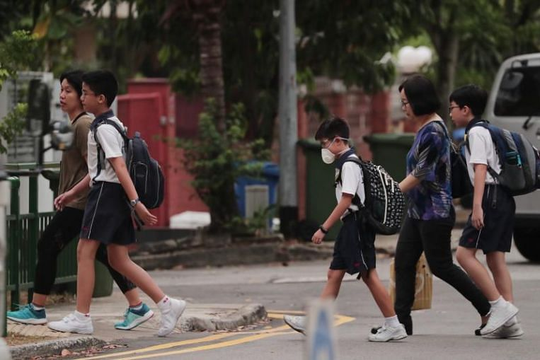 Students to take PSLE, national exams in enclosed spaces; air purifiers will be used if haze worsens: MOE