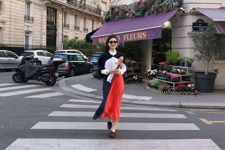 Sharon Au, who is working in France, pulled up for contacting colleagues after office hours