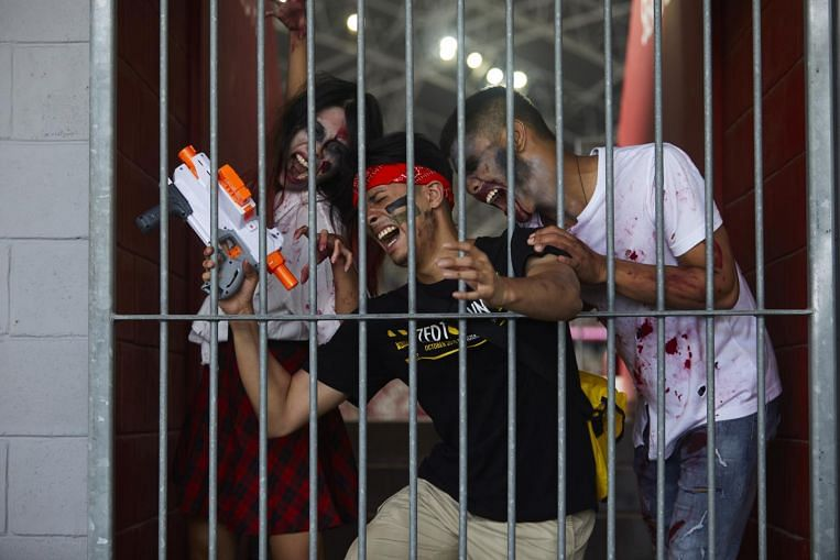 Hundreds of 'zombies' throng National Stadium for live-action survival game