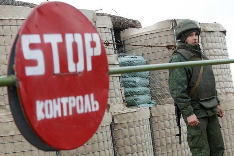 Ukraine foes to pull back troops in Donetsk region ahead of Russia summit - The Straits Times