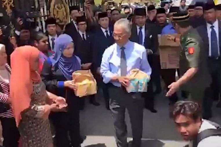 Malaysia's King treats media camped at palace to McDonald's as political turmoil continues