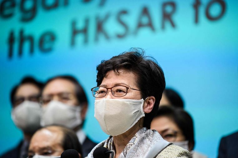 Hong Kong's leader Carrie Lam says security laws will not affect city's rights and freedoms