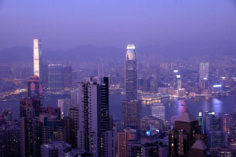 Speculators target Hong Kong's currency on outflow concern