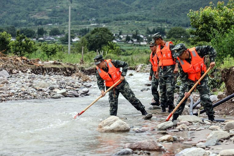 Severe floods in China leave at least 106 dead or missing