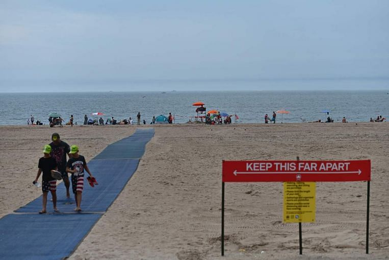 'Free again': New Yorkers, virus in mind, head back to their beaches