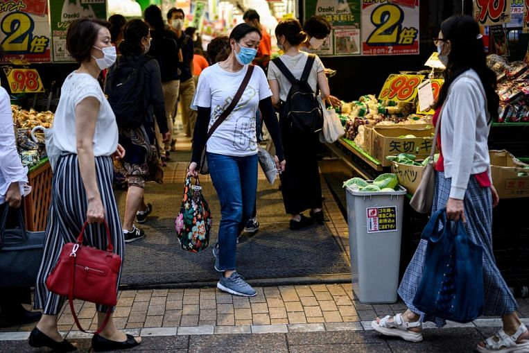 Japan household spending slumps by record as curbs hit travel, dining out