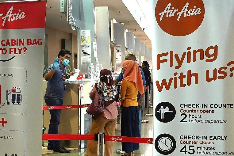 straitstimes.com - AirAsia shares slump after auditor says airline faces 'significant doubt
