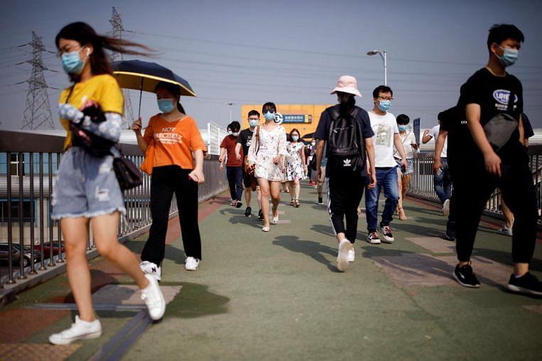 China reports 10 new coronavirus cases in mainland, nearly ...