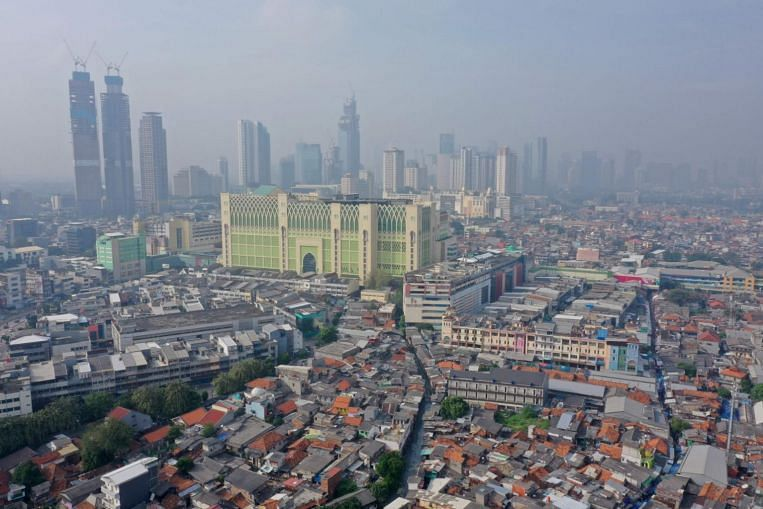 Indonesia S Coronavirus Hit Economy Shrinks For First Time Since 1999 By Sharper Than Expected 5 32 Economy News Top Stories The Straits Times
