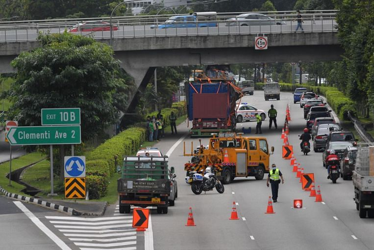 Traffic jam on AYE after goods on trailer hit flyover, driver arrested thumbnail