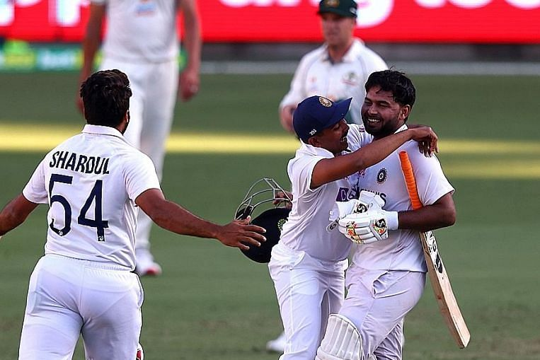 India bowled over by cricketers' historic feat