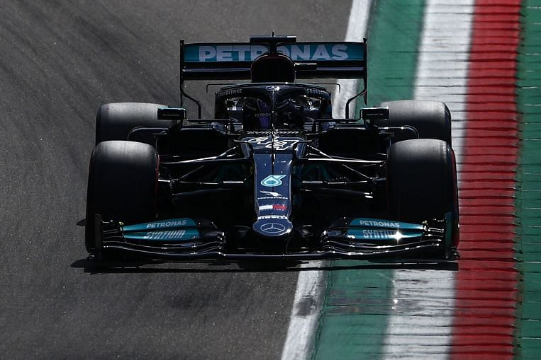 Motor racing: Hamilton takes pole at Imola with Perez on front row