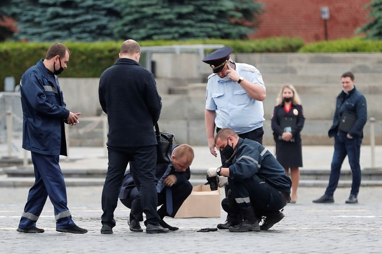 Police detain man on Moscow's Red Square after he 'kills' himself in political protest, Europe News & Top Stories