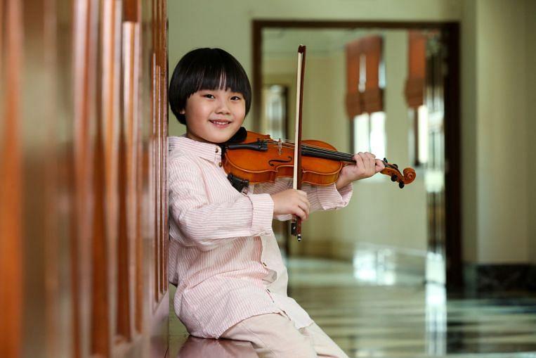Singaporean violinist scores Grade 8 distinction at five years old