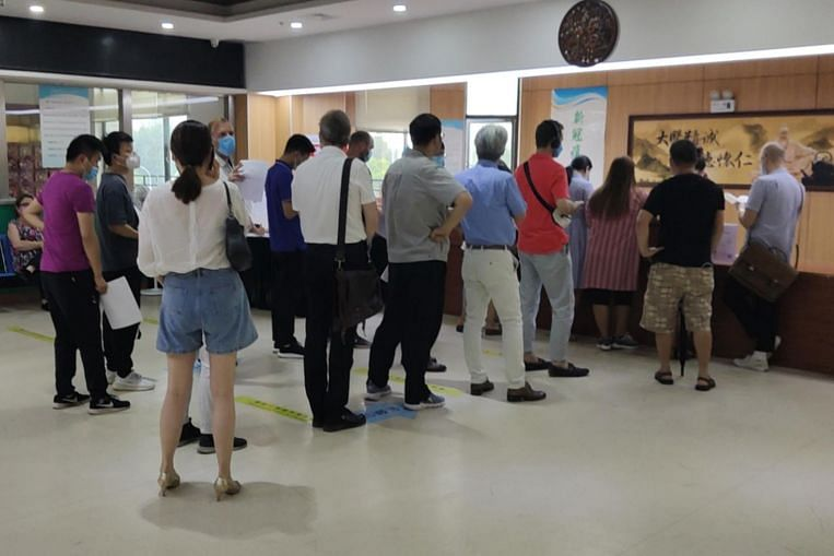 Taiwanese flying to US, China for vaccines as island's Covid-19 situation worsens