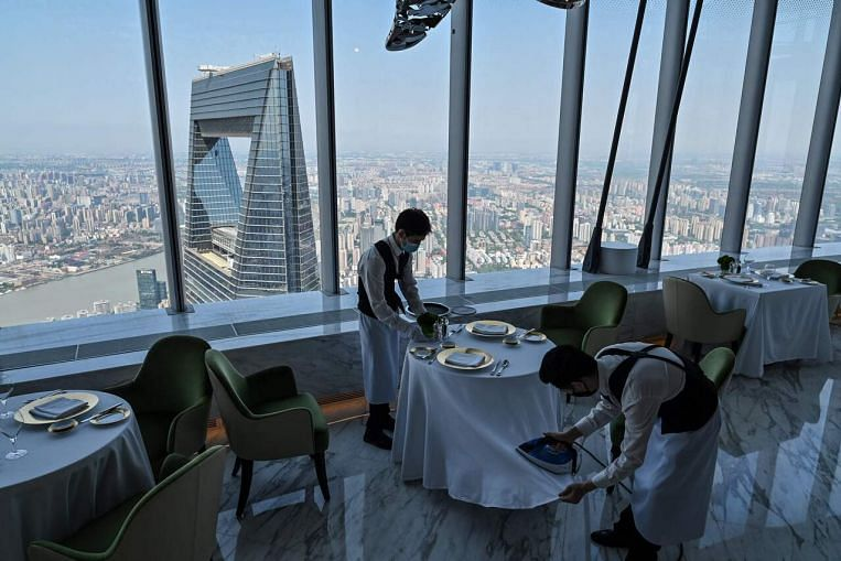 Luxury in the clouds: Shanghai opens world's tallest hotel