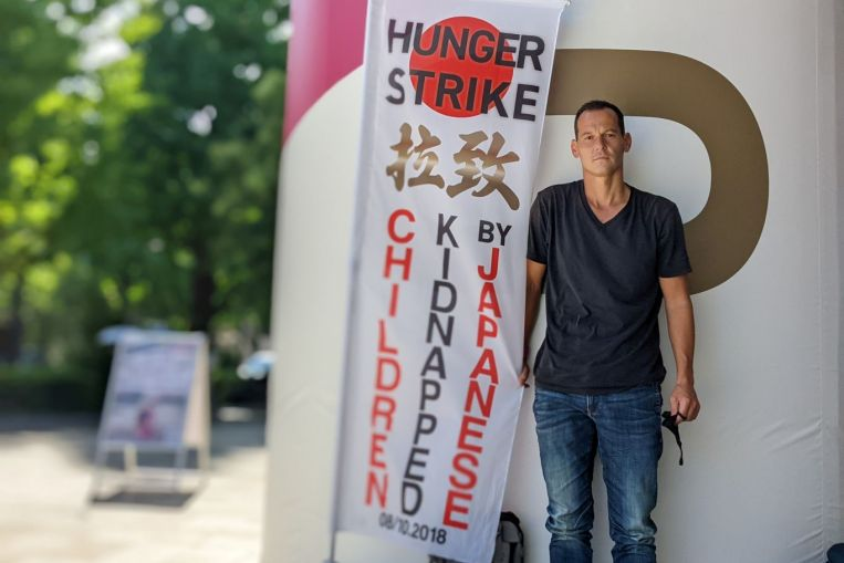 Japan-based French father on hunger strike against 'child abduction' as Olympics open