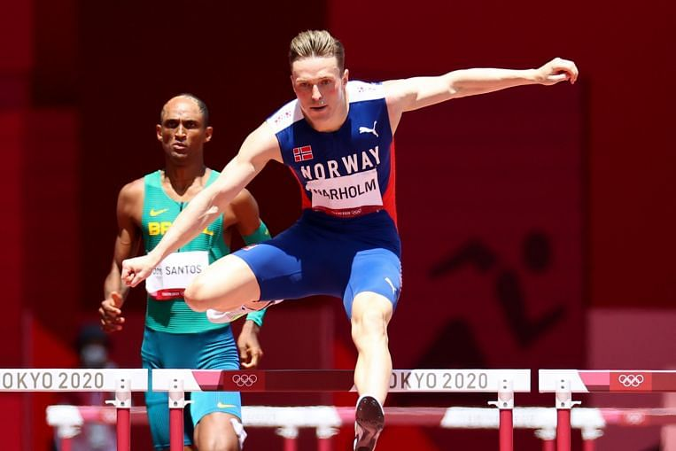 Olympics: Warholm world record in 400m hurdles victory, Mihambo soars to long jump gold - The Straits Times