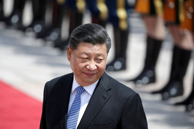 Photo of China's President Xi discusses cooperation, Afghanistan in phone call   The Straits Times