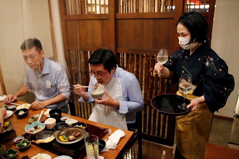 Tokyo bertujuan untuk mengurangkan kawalan Covid-19 di restoran ketika kes-kes jatuh, Berita Asia Timur & Berita Teratas